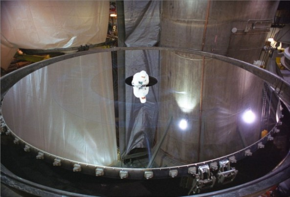 Mirror coating being inspected shortly after first aluminum coating of the Gemini North mirror in 1999